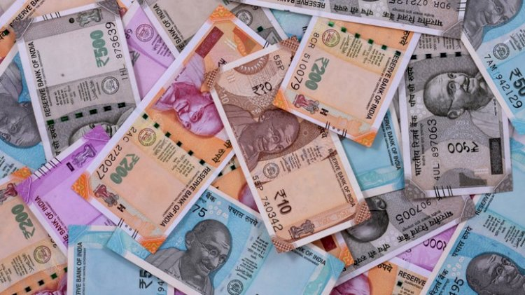Rupee pares initial losses, settles 5 paise up at 71.76 against USD